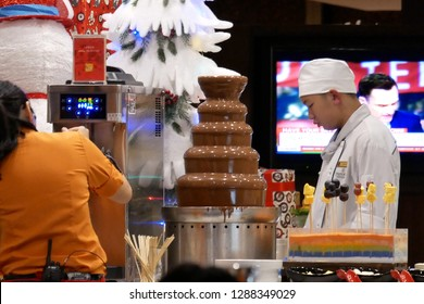 Taipei, Taiwan - December 18, 2018 : Close up of worker preparing food for customer at dessert area inside Chinese restaurant