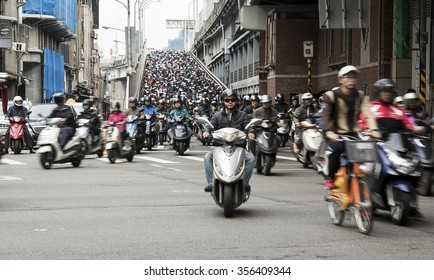 Taipei, Taiwan - December 2015 - Massive amount of people riding scooters to work on a busy  rush hour morning morning.