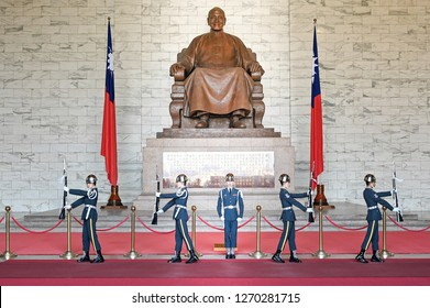 Taipei, Taiwan - DECEMBER 22, 2018 : The changing of the guards ceremony against the statue of Chiang Kai-Shek in memorial hall a famous tourist landmark at Taipei, Taiwan - Image