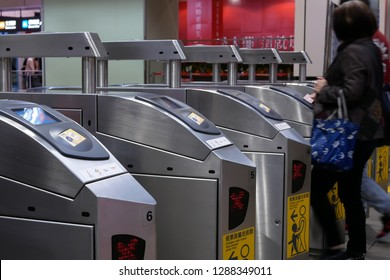 Taipei, Taiwan - December 29, 2018 : Motion of people walking through the fare of pay zone and tapping their card for taking MRT