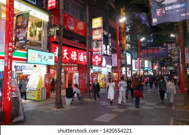 TAIPEI, TAIWAN - DECEMBER 3, 2018: People visit Ximending shopping district in Taipei. Ximending is considered one of top shopping destinations in Taiwan, catering especially youth shoppers.