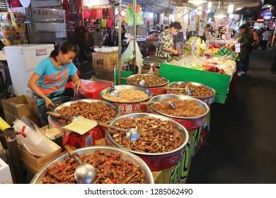 TAIPEI, TAIWAN - DECEMBER 4, 2018: People visit Raohe Night Market in Taipei. Night food markets are a big part of Taiwanese culture.
