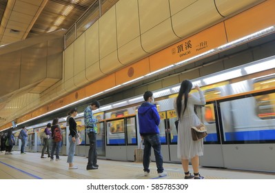 TAIPEI TAIWAN - DECEMBER 8, 2016: Unidentified people commute by subway in Taipei downtown.