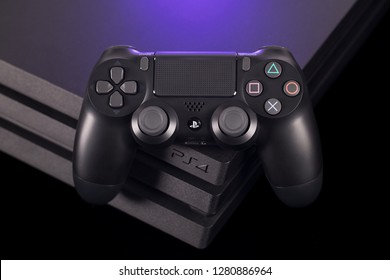 Taipei, Taiwan - December 8, 2018: A studio shot of the Sony Playstation 4 Pro with a controller on top of it.