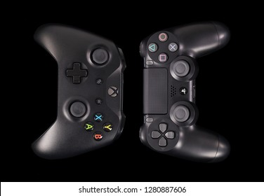 Taipei, Taiwan - December 8, 2018: A studio shot of Sony's Playstation 4 Pro and Microsoft's XBOX One X controllers together.