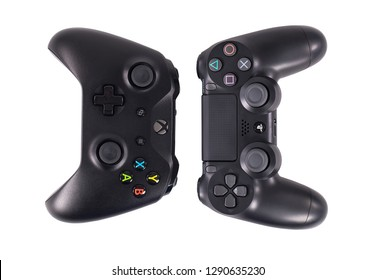 Taipei, Taiwan - December 8, 2018: A studio shot of Sony's Playstation 4 Pro and Microsoft's XBOX One X controllers together isolated on white.