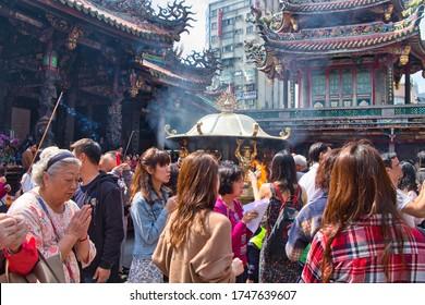 Taipei, Taiwan - February 16, 2018: Taiwanese people praying at Longshan temple in Taipei, Taiwan. Part of Taiwanese culture.