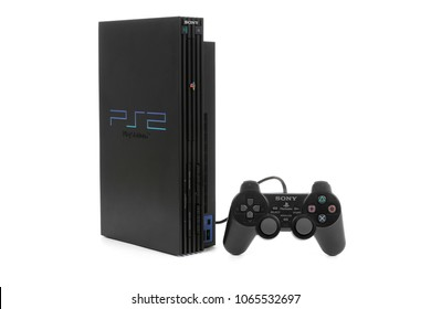 Taipei, Taiwan - February 18, 2018: A studio shot of a Sony Playstation 2 system with controller isolated on a white background.