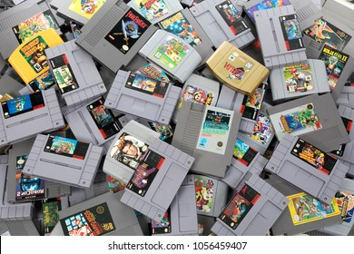 Taipei, Taiwan - February 20, 2018: A studio shot of a pile of different Nintendo games shot from above.