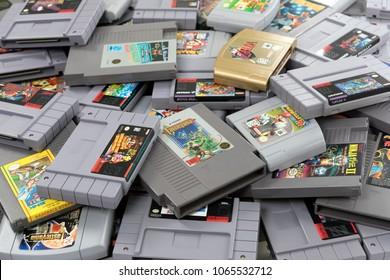 Taipei, Taiwan - February 20, 2018: A studio shot of a large pile of Nintendo cartridges.