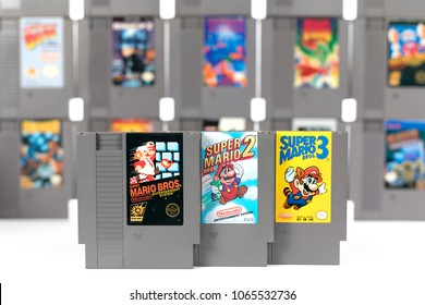 Taipei, Taiwan - February 20, 2018: A studio shot of a the three Nintendo NES Super Mario games in front of other games on a white background.