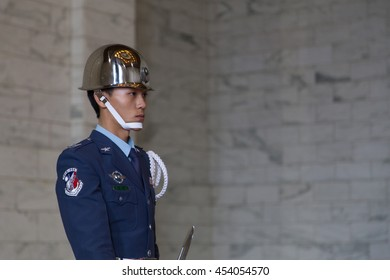 Taipei, Taiwan - January 08, 2015: Young soldier at the changing of guards ceremony inside Chiang Kai-Shek memorial hall.