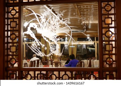 Taipei, Taiwan - January 08, 2019 : Motion of people enjoy food inside Chinese restaurant
