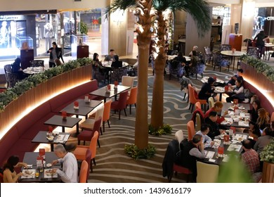 Taipei, Taiwan - January 08, 2019 : Top shot of people enjoy food inside Chinese restaurant