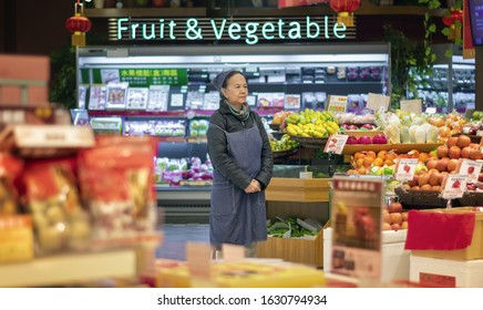 TAIPEI, TAIWAN - JANUARY 09: Unnamed supermarket employee awaits for customers as the store opens in the morning in SOGO department store in Taipei on January 09, 2020.
