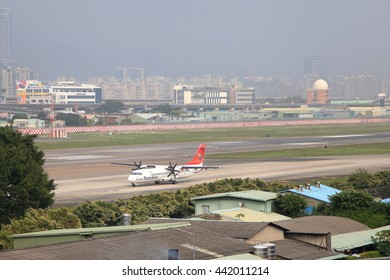 Taipei, Taiwan - January 13, 2015: The ATR72-600 plane (TransAsia Airways) is preparing  to depart from Taipei songshan international airport.
