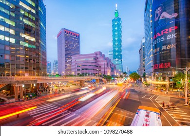 TAIPEI, TAIWAN - JANUARY 18 2018 By the corner of busy Taipei street after working hours with Taipei 101