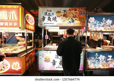 Taipei, Taiwan - January 30, 2019: Food stall selling taroyaki at the The Ningxia night Market, Taipei, Taiwan. Ningxia Night Market is one of the most popular night markets in Taipei, Taiwan