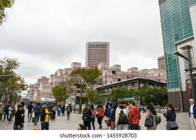 Taipei, Taiwan - January 8, 2019 - Anonymous Crowd Of People Walking At Taipei 101. The Taipei 101 Tower In Taiwan. Image For Templates, Placards, Banners, Presentations, Reports. etc