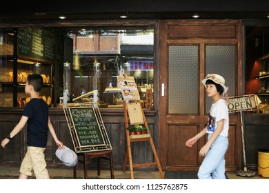 TAIPEI, TAIWAN - July 1: A view to a coffee shop in Ximending Iuly 1, 2018 in Taipei, Taiwan. The district is a center of food, drinks , fashion culture and movie center.