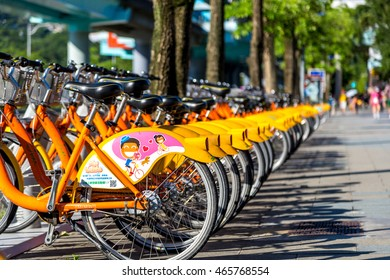 Taipei, Taiwan - July 11th 2016 - Big number of public bicycles parking in a public place in Taipei in Taiwan, Asia.