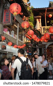 TAIPEI, TAIWAN - July 30, 2019: A view to Busy Jiufen old street with people taking pictures, New Taipei, Taiwan. At present, Jiufen is one of the most popular place for tourists to visit