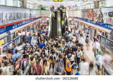 Taipei, Taiwan - July 31: A crowd captured with motion blur rushes in and out of a train in a subway (underground) station in Taipei on July 31 2013.