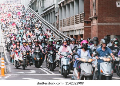 Taipei, Taiwan - July 6, 2018: Motorcycles go down the Taipei bridge during rush hour in the morning.