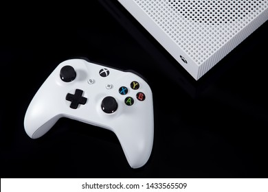 Taipei, Taiwan - June 20, 2019: A white Microsoft XBOX One S video game system and controller on a black surface