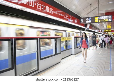 TAIPEI, TAIWAN - JUNE 20: Fast moving MRT leaving the platform on June 20, 2014 in Taipei. The MRT Subway is one of the best way to go ground Taipei city and new line is still under construction