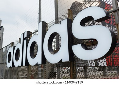 TAIPEI, TAIWAN - JUNE 24, 2018: Adidas sign located outdoor of Taipei 101 Mall, Taiwan. Adidas is a German corporation that designs footwear and clothing.