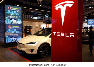 TAIPEI, TAIWAN - JUNE 26, 2018: Tesla model X on display in Syntrend shopping mall, Taipei. Tesla, Inc. is an American company specializes in electric vehicles, battery energy storage and solar panel.