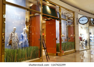TAIPEI, TAIWAN - JUNE 26, 2018: The outer facade of the Tory Burch boutique in Taipei 101 Mall. Tory Burch is an American fashion label owned, operated and founded by American designer Tory Burch.