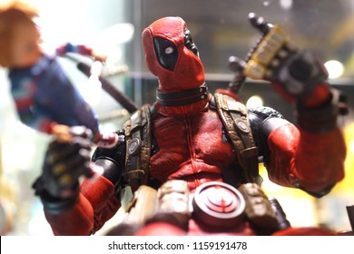 TAIPEI, TAIWAN - JUNE 26, 2018: Close up of Deadpool figures on display shelf in Ximending Mall. Deadpool is a American superhero film based on the Marvel Comics character of the same name.