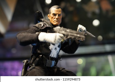 TAIPEI, TAIWAN - JUNE 26, 2018: Close up of Punisher figures on display shelf in Ximending shopping Mall. Punisher is the fictional character superheroes appearing in American comic books by Marvel.
