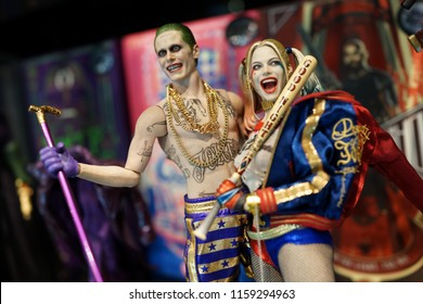 TAIPEI, TAIWAN - JUNE 26, 2018: Close up of Joker and Harley Quinn figures on display shelf in Ximending Mall. Suicide Squad is a 2016 American superhero film based on the DC Comics supervillain team.