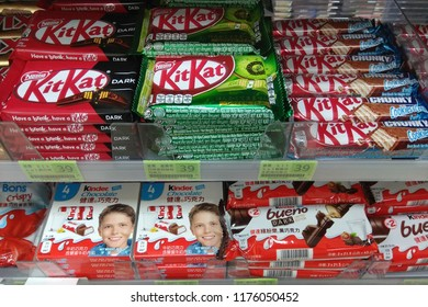TAIPEI, TAIWAN - JUNE 26, 2018: Various brand of chocolate bars on display shelf in 7-Eleven Store. 7-Eleven is a Japanese-owned American international chain of convenience stores, HQ in Texas.