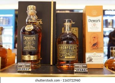 TAIPEI, TAIWAN - JUNE 27, 2018: Dewar's blended scotch whisky on store shelf in Taoyuan Airport. Dewar's is a brand of blended Scotch whisky owned by Bacardi.