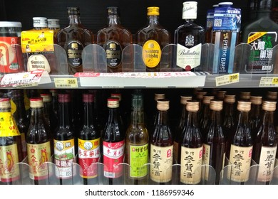 TAIPEI, TAIWAN - JUNE 27, 2018 : Various brand of hard liquor display for sale in 7-Eleven store. 7-Eleven is a Japanese-owned American international chain of convenience stores, HQ in Texas.