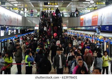 Taipei, Taiwan - March 05, 2017: Crowded Taipei City Hall subway station during rush hour in Taipei, Taiwan.