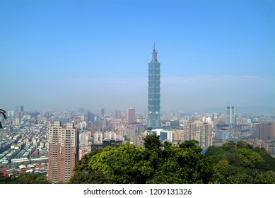 Taipei, Taiwan - March 10, 2004: Mist covers the tallest building in Taiwan and towers into the sky.