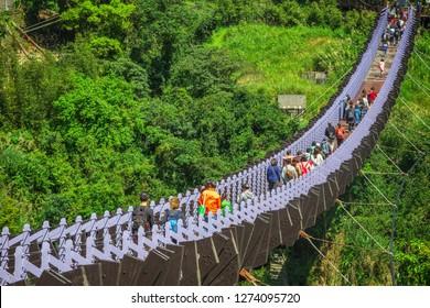 Taipei, Taiwan - March 10, 2018 - Tourists crossing Baishihu Suspension Bridge in Neihu district