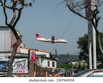 TAIPEI, TAIWAN - March 12, 2019: Far Eastern Air Transport small airplane (ATR 72-600) landing at Taipei Songshan Airport in Taiwan.