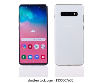 Taipei, Taiwan - March 7, 2019: A studio shot of the new Samsung Galaxy S10+ cellphone on a reflective white surface.