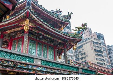 Taipei, Taiwan - May 01, 2016: Close up view of Longshan Temple in rainy day. Longshan Temple of Manka is a Buddhist temple in Wanhua District, Taipei, Taiwan.