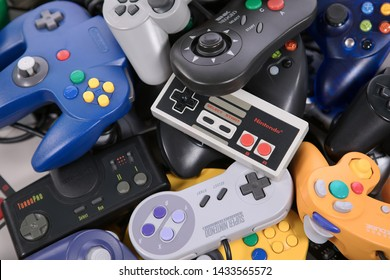 Taipei, Taiwan - May 1, 2019: A large pile of retro video game controllers