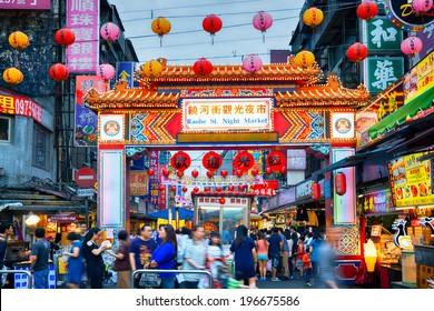 TAIPEI - TAIWAN,  MAY 11, 2014: Entrance of Raohe Street Night Market in Taipei. on May 11. Raohe Night Market is popular among tourists.