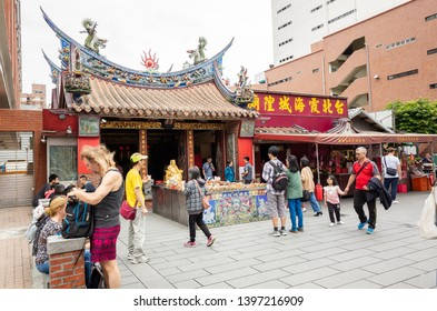 Taipei, Taiwan - May 11th, 2019:famous attraction of Taipei Xia Hai City God Temple with people, Taipei, Taiwan, Asia