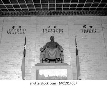 Taipei, Taiwan - May 13, 2019: A large bronze statue of Chiang Kai-shek in the main chamber of the Chiang Kai-shek Memorial Hall in Taipei, Taiwan.