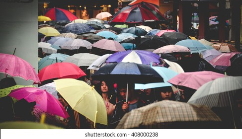 TAIPEI, TAIWAN - MAY 14, 2011: Umbrellas in a busy street in Taipei, Taiwan